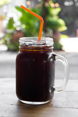 iced coffee: Delicious ice coffee americano on wood table.