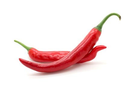 chilli: Hot red chili or chilli pepper isolated on white background.
