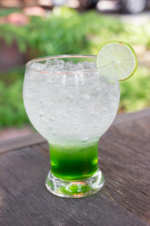 cocktail drinks: Kiwi italian soda.Colorful cocktail drink on wood table Stock Photo