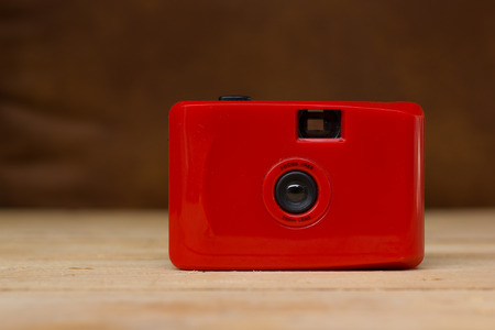 35 mm: Red compact film camera. 35 mm photo camera .