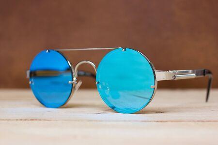 mirrored: fashion sunglasses. Sunglasses with mirror lenses. Stock Photo