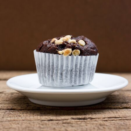 Homemade delicious chocolate muffin, close-up.
