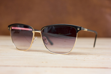 fashion sunglasses on , wooden table