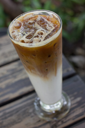 cold late coffee drink with ice on table. Stock Photo