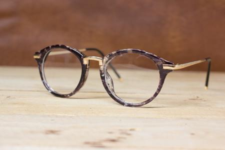 eyeglasses ,  on wood background.