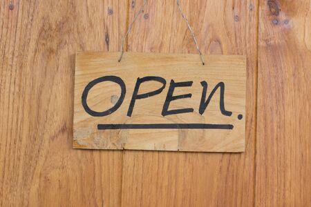 Vintage open sign on old wooden door. Stock Photo