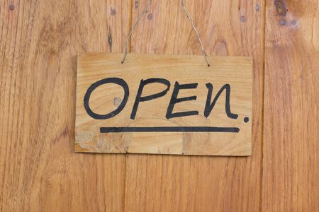 old sign: Vintage open sign on old wooden door. Stock Photo