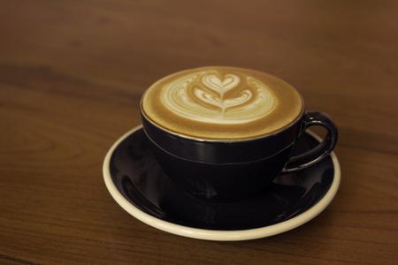 coffee latte art , vintage color tone filter. Stock Photo