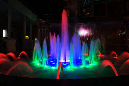 a beautiful fountain is at night in city of Sochi, Russia photo