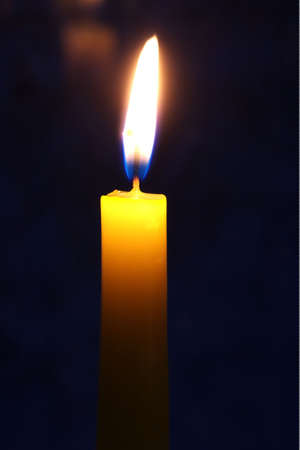conflagrant: conflagrant candle on a dark background Stock Photo