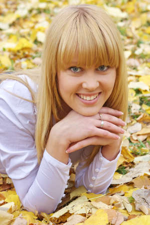 young beautiful woman  in an autumn park photo