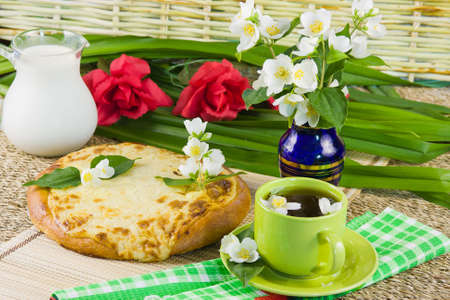 tea with jasmin and potato pie photo