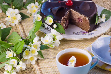 green tea with jasmin and cake photo