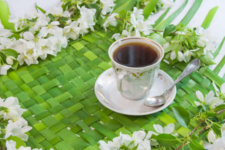 cup of coffee with the sprigs of flowering apple-tree Stock Photo