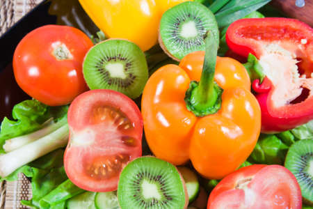 Varicoloured fruit and vegetables lie on a dish Stock Photo - 16706471