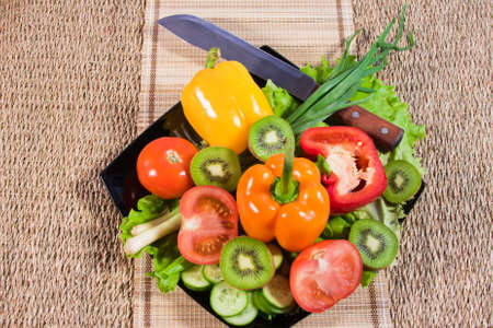 Varicoloured fruit and vegetables lie on a dish Stock Photo - 16706577