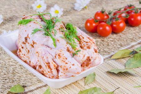 chicken carcass with seasoning and tomatoes with fresh greenery Stock Photo - 16714610