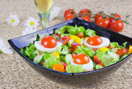 lettuce from vegetables with fresh greenery  in a decorative dish photo