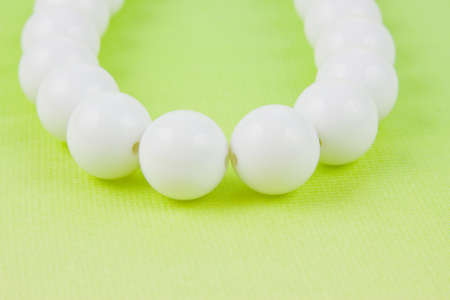woman white beads on a light green background photo