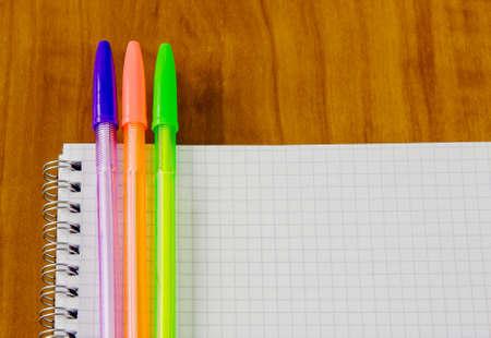 belonging: school belonging, notebook and three pens