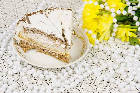 yellow chrysanthemums, piece of cake and beads photo