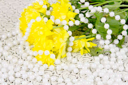 yellow chrysanthemums and beads are pearls photo