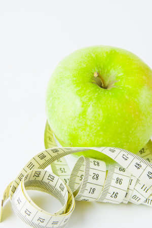 green apple and centimetre on a white background Stock Photo - 17278988