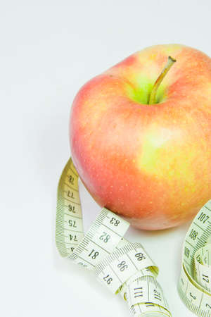 centimetre: red apple and centimetre on a white background Stock Photo