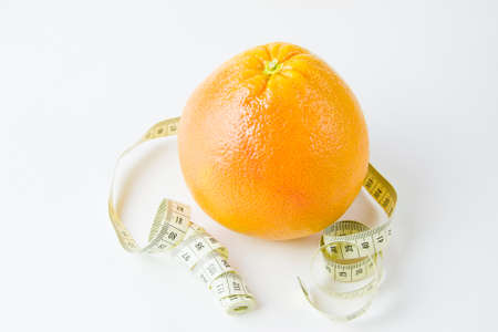 orange and centimetre on a white background photo