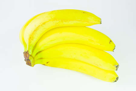 ripe bananas on a white background photo