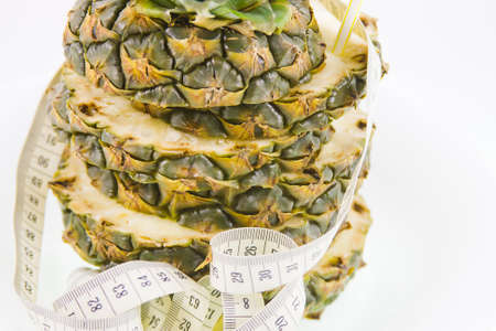 pineapple  and measuring ribbon on a white background Stock Photo - 17279012