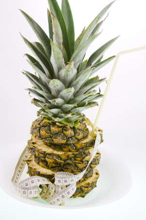 pineapple  and measuring ribbon on a white background Stock Photo - 17278994