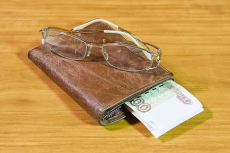 thousandth: purse, Russian money and glasses