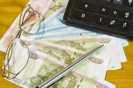 thousandth: Russian money, a calculator,is glasses and pen Stock Photo