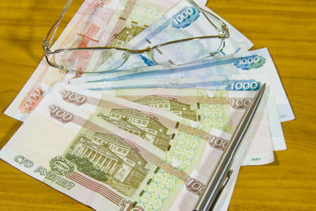 thousandth: Russian money,is glasses and pen