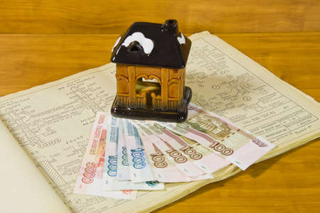 accumulations: toy house and Russian money on project documentation