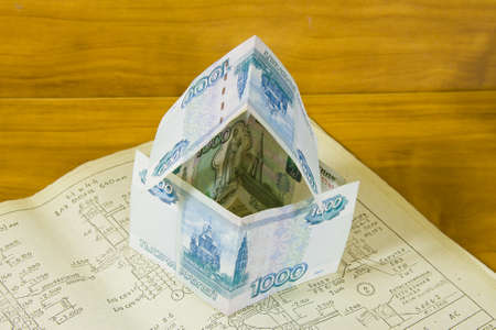 accumulations: house from Russian money  on project documentation Stock Photo