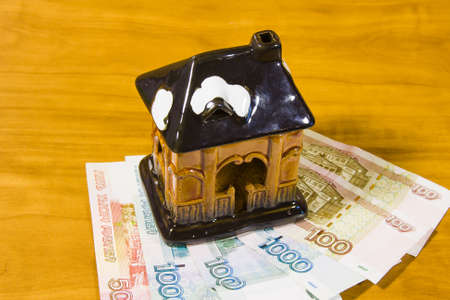 accumulations: a toy house and Russian money