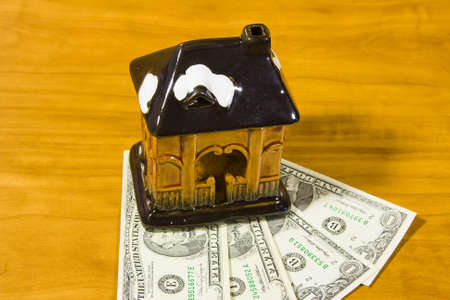 toy house and dollars photo