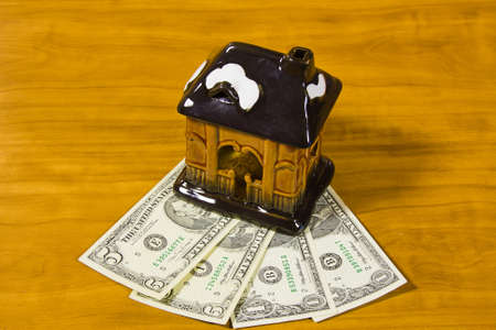 accumulations: toy house and dollars