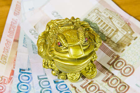 accumulations: a souvenir is a frog and Russian money