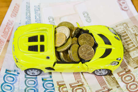 toy car and Russian money photo