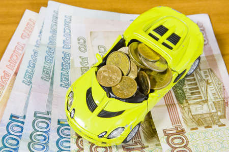 accumulations: toy car and Russian money