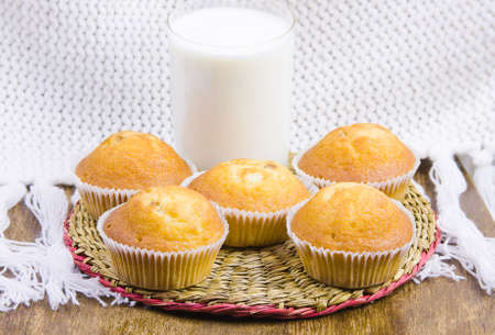 sweet vanilla domestic cakes and glass with milk photo