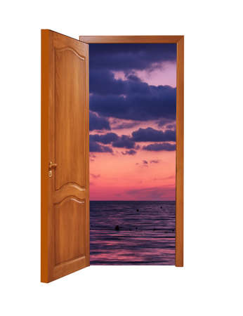 unclosed: unclosed wooden door with a kind on beautiful sunset at the seaside on a white background, isolated