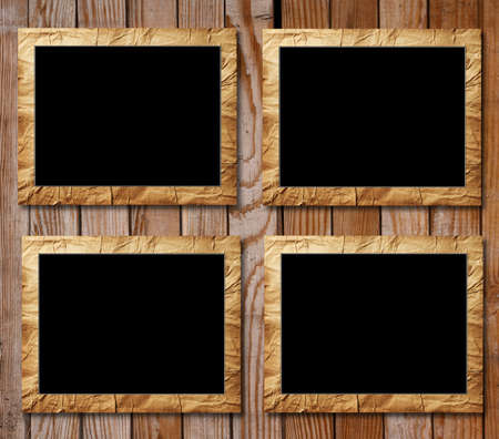 four placards of black in decorative scopes on a wooden background photo