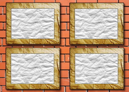crushed: four placards with the crushed paper in decorative scopes on a brick background Stock Photo