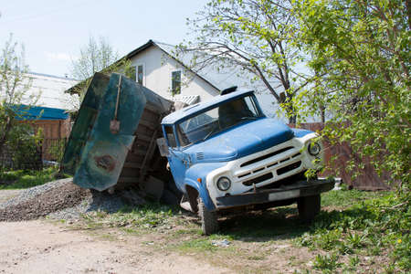 a truck with a load fell down on a starboard Stock Photo