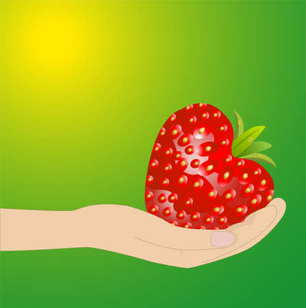 deliciously: ripe berries of strawberry in a hand on a green background