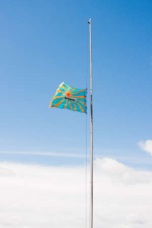 uplifting: Raising of a flag of aircraft on a background of the blue sky